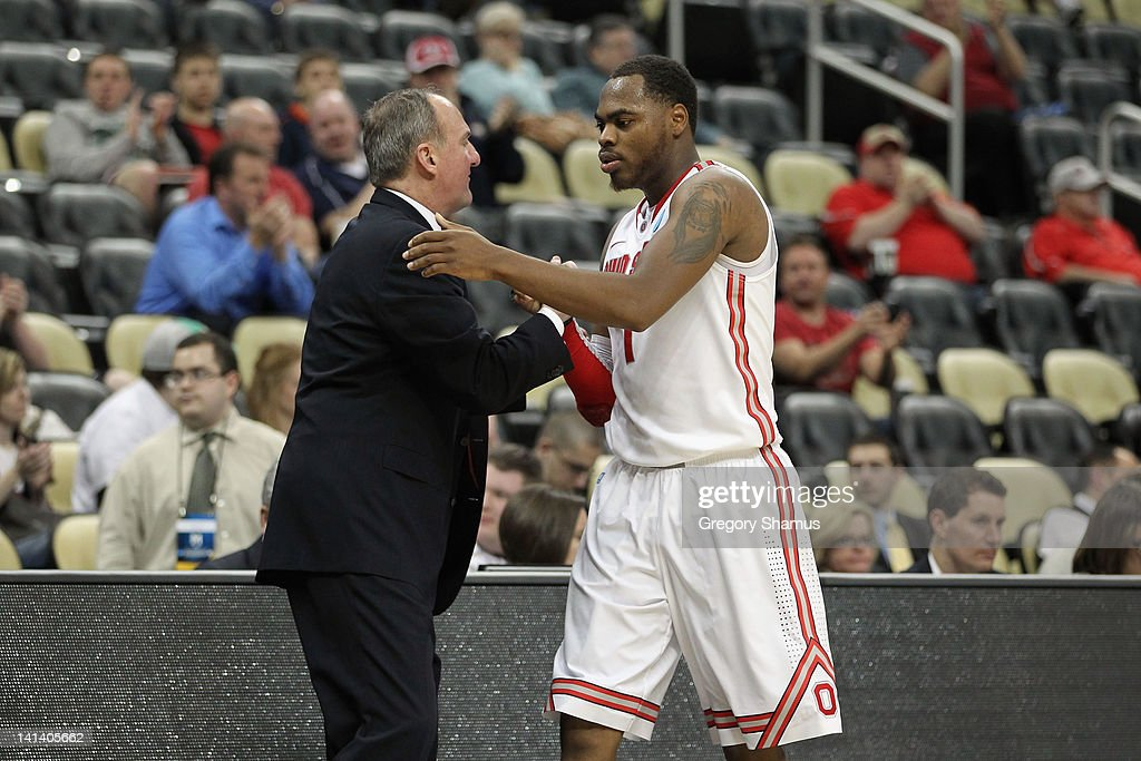 Head coach <a gi-track='captionPersonalityLinkClicked' href=/galleries/search?phrase=Thad+Matta&family=editorial&specificpeople=799910 ng-click='$event.stopPropagation()'>Thad Matta</a> (L) of the Ohio State Buckeyes shakes hands with Deshaun Thomas (R) #1 after defeating the Loyola Greyhounds during the second round of the 2012 NCAA Men's Basketball Tournament at Consol Energy Center on March 15, 2012 in Pittsburgh, Pennsylvania.