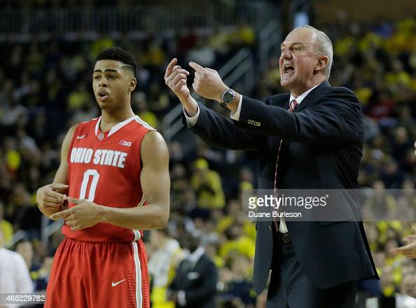 Head coach Thad Matta of the Ohio State Buckeyes shouts to his team as D'Angelo Russell of the Ohio State Buckeyes looks on during the second half of...