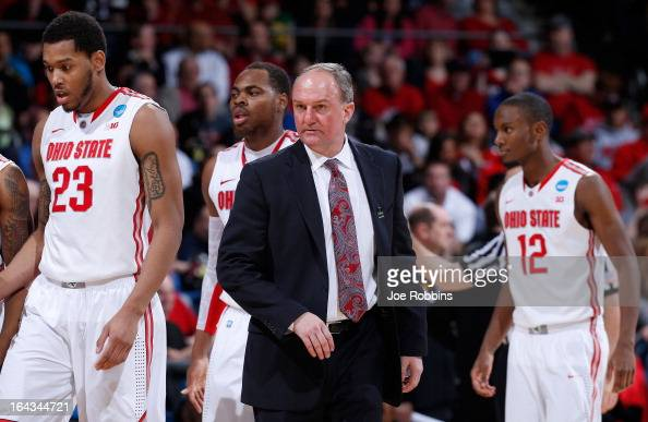Head coach Thad Matta of the Ohio State Buckeyes speaks to his players Amir Williams Deshaun Thomas and Sam Thompson of the Ohio State Buckeyes in...