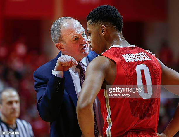 Head coach Thad Matta of the Ohio State Buckeyes talks to D'Angelo Russell of the Ohio State Buckeyes during the game against the Indiana Hoosiers at...