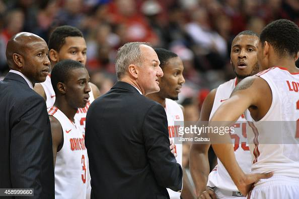 Head Coach Thad Matta of the Ohio State Buckeyes talks to his team during a timeout in a game against the MassachusettsLowell River Hawks on November...