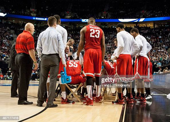 Head coach Thad Matta of the Ohio State Buckeyes talks to his team during a timeout against the Arizona Wildcats during a third round game of the...