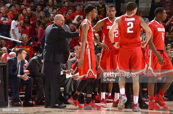 Head coach Thad Matta of the Ohio State Buckeyes talks to his team during a timeout in the game against the Maryland Terrapins at Xfinity Center on...