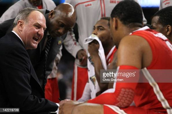Head coach Thad Matta of the Ohio State Buckeyes talks to his team in the huddle in the first half while taking on the Kansas Jayhawks during the...