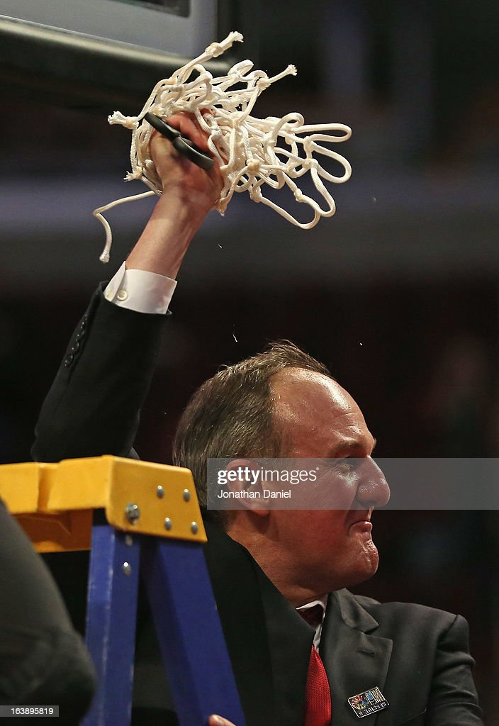 Head coach Thad Matta of the Ohio State Buckeyes waves the net after the Buckeyes defeated the Wisconsin Badgers during the Big Ten Basketball Tournament Championship game at United Center on March 17, 2013 in Chicago, Illinois. Ohio State defeats Wisconsin 50-43.