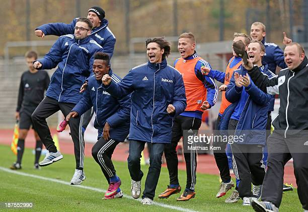 Head coach Thomas Brdaric and his team of Neustrelitz jubilate after Velimir Jovanovic scoring the second goal during the Regionalliga Nordost match...