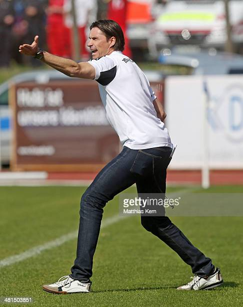 Head coach Thomas Brdaric of Neustrelitz gestures during the Regionalliga Nordost match between TSG Neustrelitz and 1FC Magdeburg at Parkstadion on...