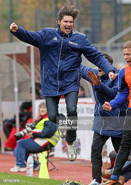Head coach Thomas Brdaric of Neustrelitz jubilates after Velimir Jovanovic scoring the second goal during the Regionalliga Nordost match between...