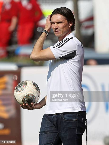 Head coach Thomas Brdaric of Neustrelitz looks on during the Regionalliga Nordost match between TSG Neustrelitz and 1FC Magdeburg at Parkstadion on...
