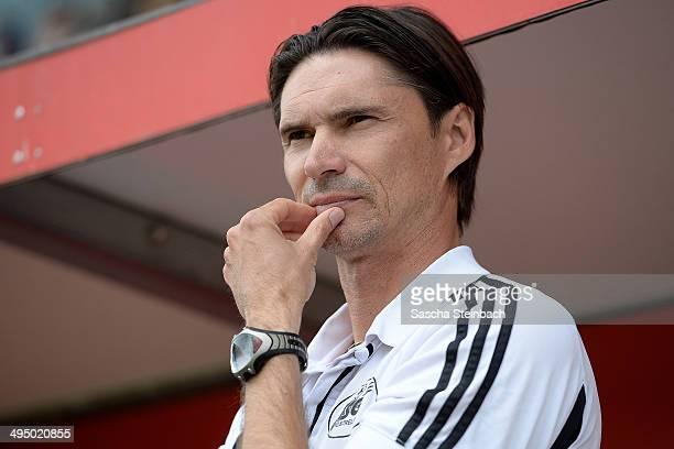 Head coach Thomas Brdaric of Neustrelitz reacts prior to the 3 Liga playoff leg 2 match between 1 FSV Mainz 05 II and TSG Neustrelitz at...
