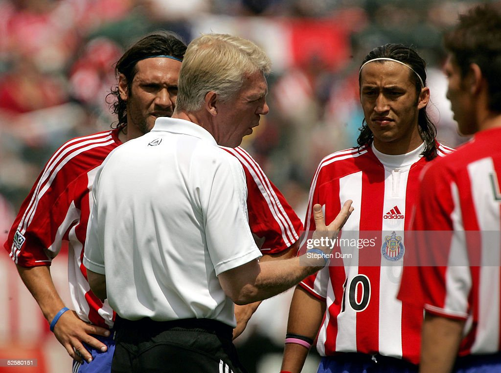 Head coach Thomas Rongen of Chivas USA gives instructions to his team including Hector Cuadros before their Major League Soccer match with DC United...