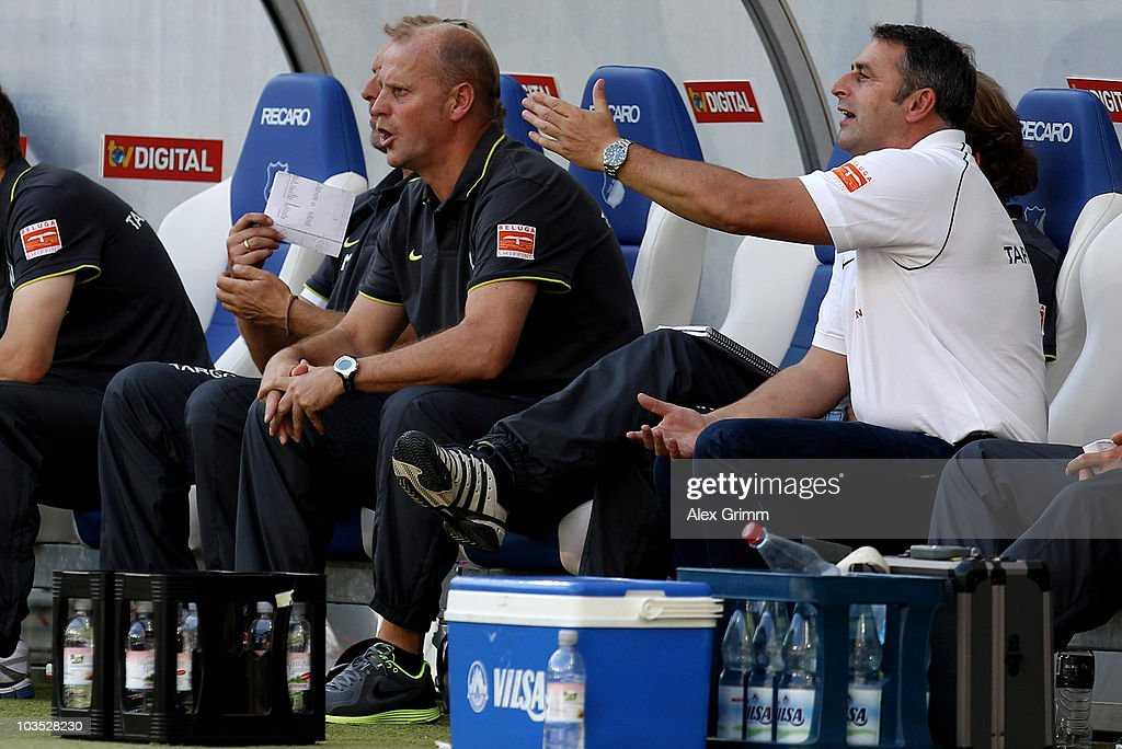 Head coach <a gi-track='captionPersonalityLinkClicked' href=/galleries/search?phrase=Thomas+Schaaf&family=editorial&specificpeople=216597 ng-click='$event.stopPropagation()'>Thomas Schaaf</a> (L) and manager <a gi-track='captionPersonalityLinkClicked' href=/galleries/search?phrase=Klaus+Allofs&family=editorial&specificpeople=634763 ng-click='$event.stopPropagation()'>Klaus Allofs</a> react during the Bundesliga match between 1899 Hoffenheim and Werder Bremen at the Rhein-Neckar Arena on August 21, 2010 in Sinsheim, Germany.