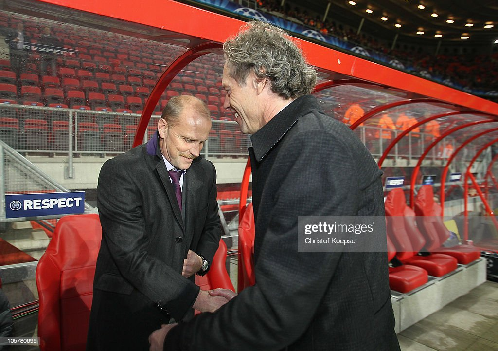 Head coach <a gi-track='captionPersonalityLinkClicked' href=/galleries/search?phrase=Thomas+Schaaf&family=editorial&specificpeople=216597 ng-click='$event.stopPropagation()'>Thomas Schaaf</a> of Bremen and head coach <a gi-track='captionPersonalityLinkClicked' href=/galleries/search?phrase=Michel+Preud%27homme&family=editorial&specificpeople=2514028 ng-click='$event.stopPropagation()'>Michel Preud'homme</a> of Enschede shake hands before the UEFA Champions League group A match between FC Twente and SV Werder Bremen at FC Twente stadium on October 20, 2010 in Enschede, Netherlands.