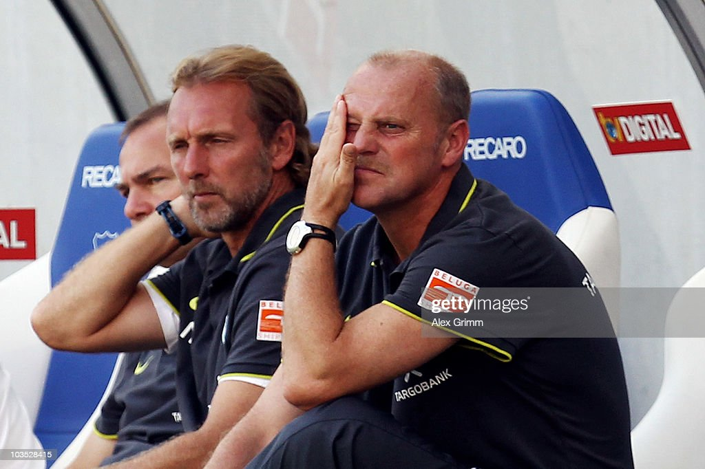 Head coach <a gi-track='captionPersonalityLinkClicked' href=/galleries/search?phrase=Thomas+Schaaf&family=editorial&specificpeople=216597 ng-click='$event.stopPropagation()'>Thomas Schaaf</a> (front) of Bremen reacts during the Bundesliga match between 1899 Hoffenheim and Werder Bremen at the Rhein-Neckar Arena on August 21, 2010 in Sinsheim, Germany.