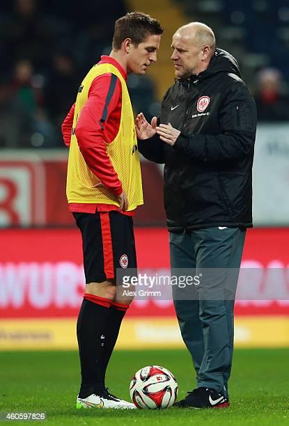 Head coach Thomas Schaaf of Frankfurt talks to Bastian Oczipka prior to the Bundesliga match between Eintracht Frankfurt and Hertha BSC at...