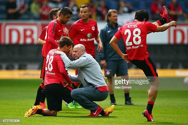 Head coach Thomas Schaaf of Frankfurt talks to Makoto Hasebe prior to the Bundesliga match between Eintracht Frankfurt and 1899 Hoffenheim at...