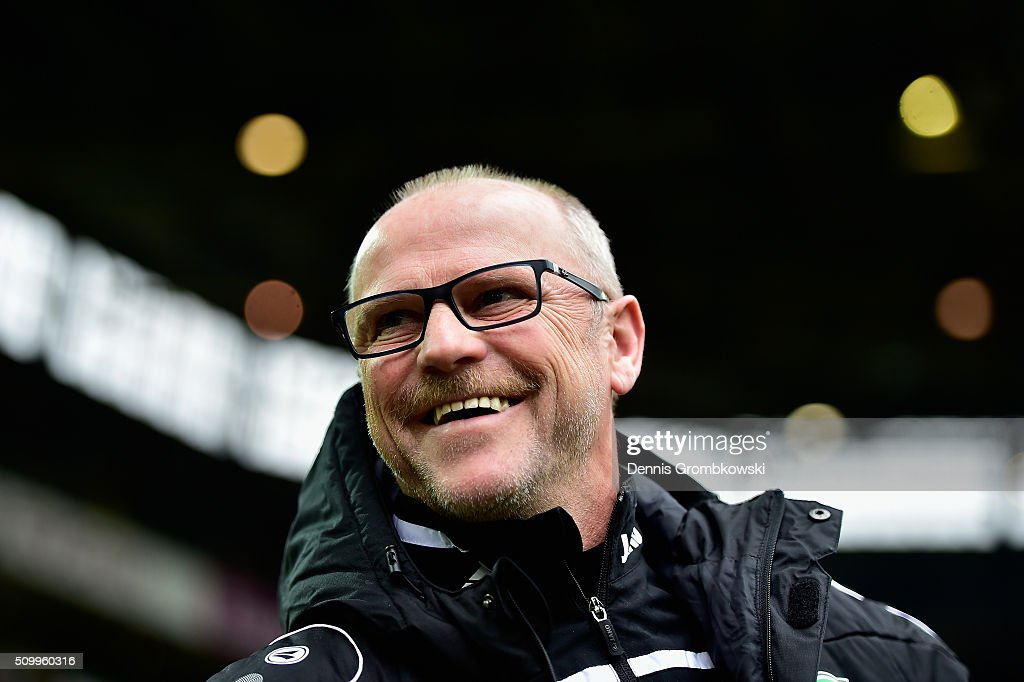 Head coach <a gi-track='captionPersonalityLinkClicked' href=/galleries/search?phrase=Thomas+Schaaf&family=editorial&specificpeople=216597 ng-click='$event.stopPropagation()'>Thomas Schaaf</a> of Hannover 96 reacts prior to kickoff during the Bundesliga match between Borussia Dortmund and Hannover 96 at Signal Iduna Park on February 13, 2016 in Dortmund, Germany.