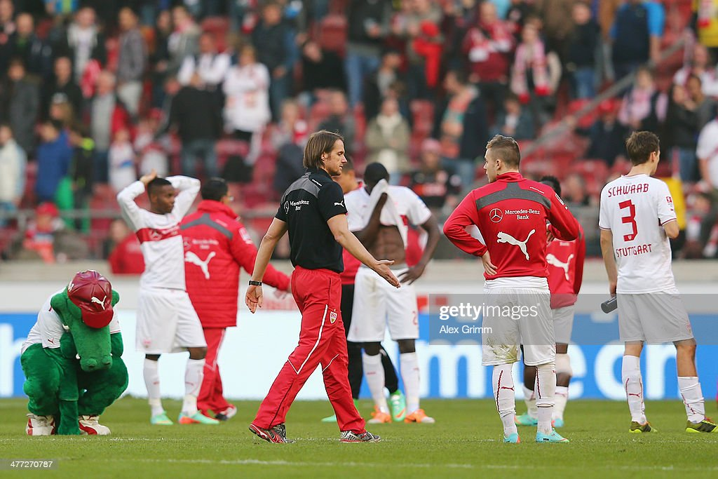 Head coach Thomas Schneider and players of Stuttgart react after the Bundesliga match between VfB Stuttgart and Eintracht Braunschweig at...