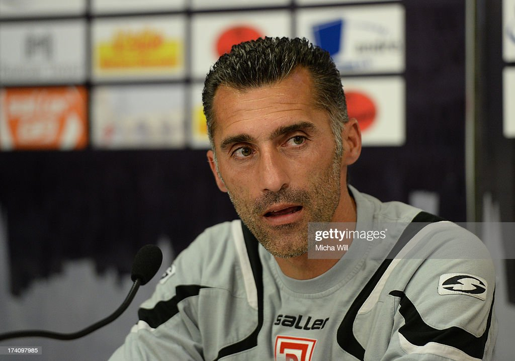 head coach Thomas Stratos of Regensburg speaks during the press conference after the Third League match between Jahn Regensburg and SpVgg Unterhaching at Jahnstadion on July 20, 2013 in Regensburg, Germany.