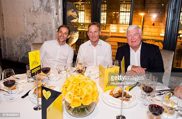 Head coach Thomas Tuchel and CEO HansJoachim Watzke of Borussia Dortmund together with Dr Klaus Engel CEO of Evonik Industries AG during the Puma...
