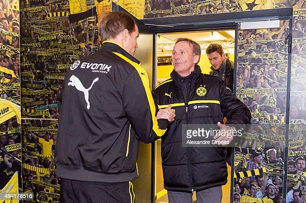 Head coach Thomas Tuchel and CEO HansJoachim Watzke of Borussia Dortmund shake hands prior to the Bundesliga match between Borussia Dortmund and FC...