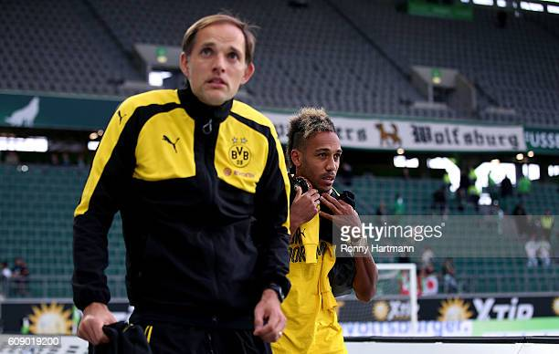 Head coach Thomas Tuchel and PierreEmerick Aubameyang of Dortmund react during a false alarm prior to the Bundesliga match between VfL Wolfsburg and...