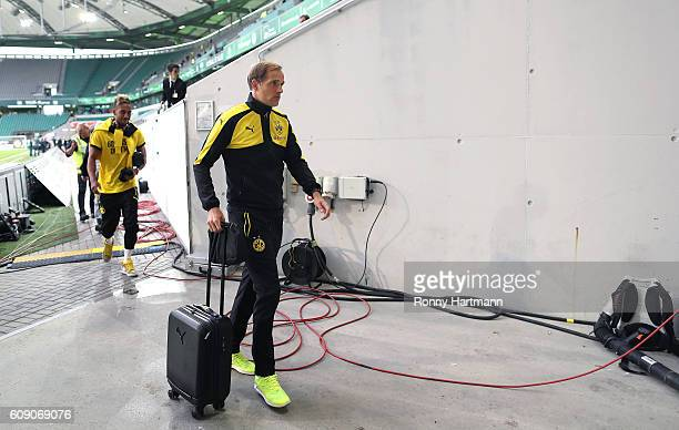 Head coach Thomas Tuchel and PierreEmerick Aubameyang of Dortmund leave the stadium during a false alarm prior to the Bundesliga match between VfL...