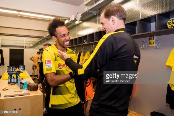 Head coach Thomas Tuchel celebrates PierreEmerick Aubameyang of Borussia Dortmund for getting the trophy for being the top scorer of this season...