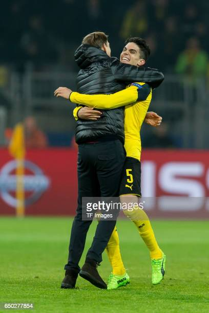 Head coach Thomas Tuchel of Borussia Dortmund and Marc Bartra of Borussia Dortmund celebrate their win after the UEFA Champions League Round of 16...