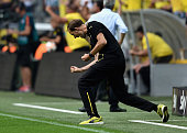 Head coach Thomas Tuchel of Borussia Dortmund celebrates as Marco Reus scores the opening goal during the Bundesliga match between Borussia Dortmund...