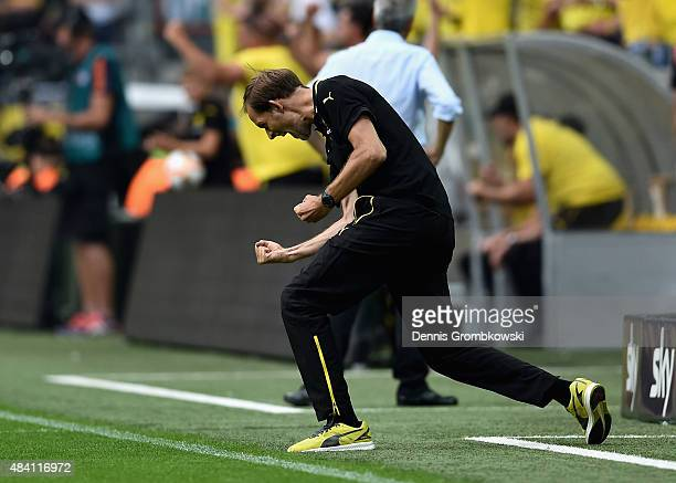 Head coach Thomas Tuchel of Borussia Dortmund celebrates as Marco Reus scores the opening goal during the Bundesliga match between Borussia Dortmund...