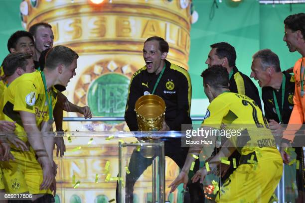 Head coach Thomas Tuchel of Borussia Dortmund celebrates at the medal ceremony after the DFB Cup Final match between Eintracht Frankfurt and Borussia...
