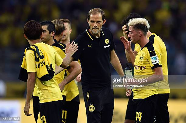 Head coach Thomas Tuchel of Borussia Dortmund celebrates with players after the Bundesliga match between Borussia Dortmund and Borussia...