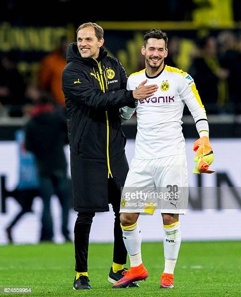 Head coach Thomas Tuchel of Borussia Dortmund hugs goalkeeper Roman Buerki of Borussia Dortmund after winning the Bundesliga match between Borussia...