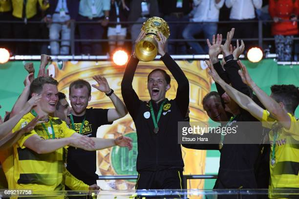 Head coach Thomas Tuchel of Borussia Dortmund lifts the trophy at the medal ceremony after the DFB Cup Final match between Eintracht Frankfurt and...