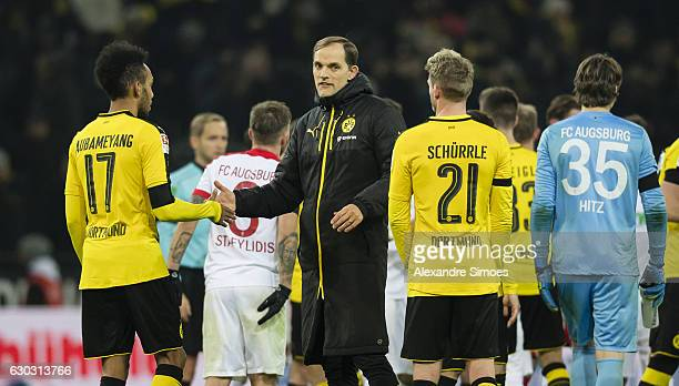 Head coach Thomas Tuchel of Borussia Dortmund together with PierreEmerick Aubameyang and Andre Schuerlle after the final whistle during the...
