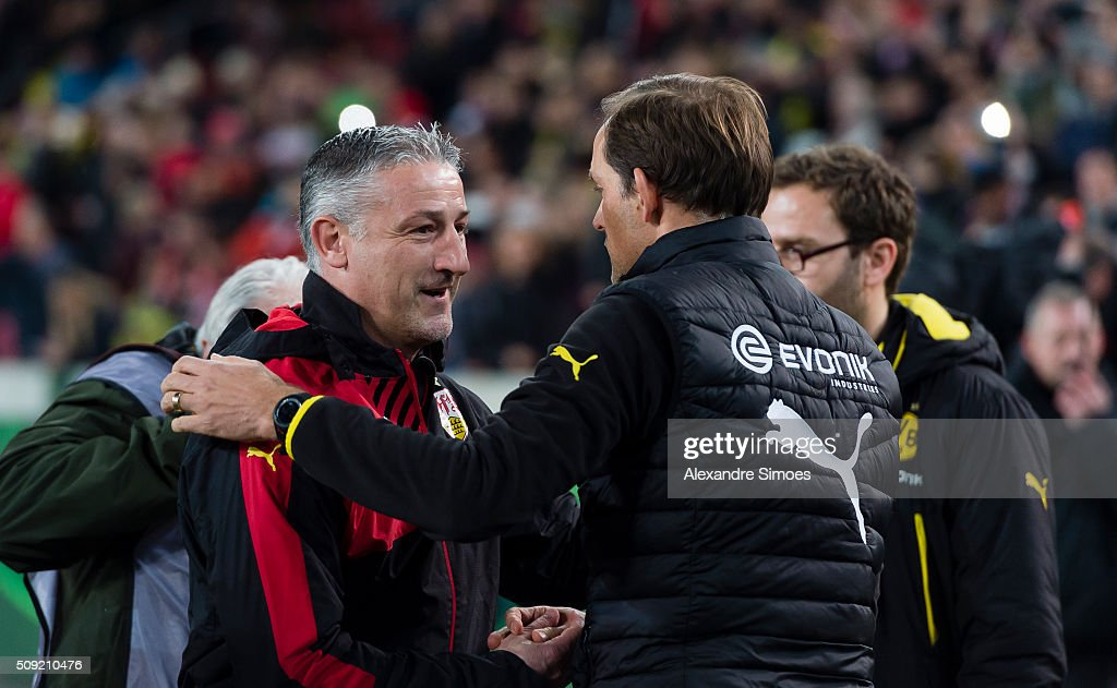 Head coach <a gi-track='captionPersonalityLinkClicked' href=/galleries/search?phrase=Thomas+Tuchel&family=editorial&specificpeople=5927236 ng-click='$event.stopPropagation()'>Thomas Tuchel</a> of Borussia Dortmund together with head coach of Stuttgart Juergen Kramny prior to the DFB Cup match between VfB Stuttgart and Borussia Dortmund at Mercedes-Benz Arena on February 09, 2016 in Stuttgart, Germany.