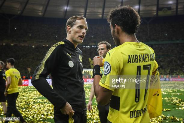 Head coach Thomas Tuchel of Dortmund and PierreEmerick Aubameyang of Dortmund talk after the DFB Cup final match between Eintracht Frankfurt and...