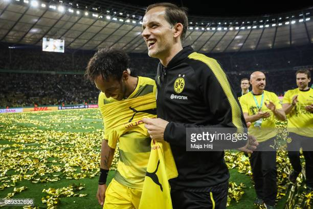 Head coach Thomas Tuchel of Dortmund and PierreEmerick Aubameyang of Dortmund celebrate after the DFB Cup final match between Eintracht Frankfurt and...