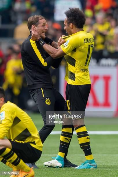 Head coach Thomas Tuchel of Dortmund and PierreEmerick Aubameyang of Dortmund celebrate their win during the Bundesliga match between Borussia...
