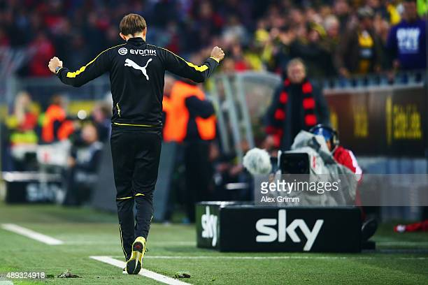 Head coach Thomas Tuchel of Dortmund celebrates after the Bundesliga match between Borussia Dortmund and Bayer Leverkusen at Signal Iduna Park on...