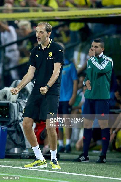 Head coach Thomas Tuchel of Dortmund celebrates the forth goal of his team during the UEFA Europa League third Qualifying round 2nd leg match between...