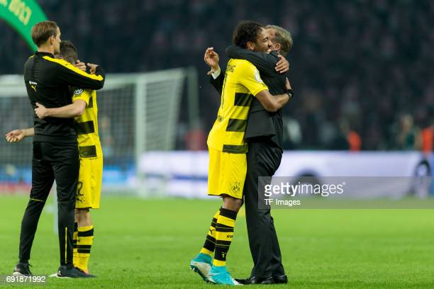 Head coach Thomas Tuchel of Dortmund Christian Pulisic of Dortmund PierreEmerick Aubameyang of Dortmund and CEO HansJoachim Watzke of Dortmund...