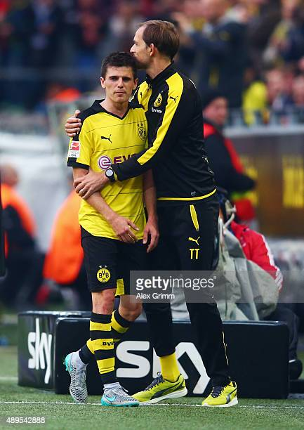 Head coach Thomas Tuchel of Dortmund hugs Jonas Hofmann during the Bundesliga match between Borussia Dortmund and Bayer Leverkusen at Signal Iduna...