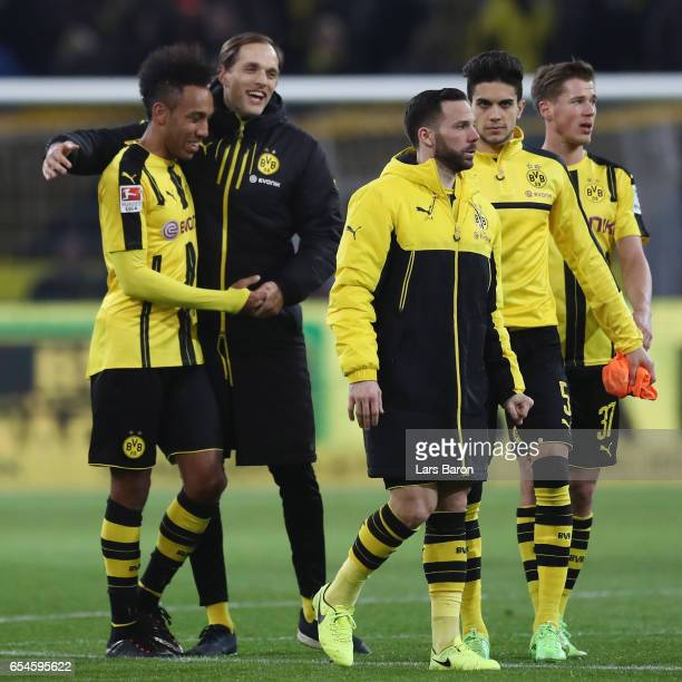 Head coach Thomas Tuchel of Dortmund hugs PierreEmerick Aubameyang after the Bundesliga match between Borussia Dortmund and FC Ingolstadt 04 at...