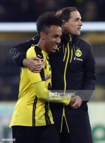 Head coach Thomas Tuchel of Dortmund hugs PierreEmerick Aubameyang after the Bundesliga match between Borussia Dortmund and FC Ingolstadt 04 at...
