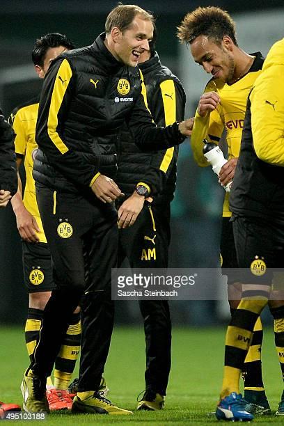 Head coach Thomas Tuchel of Dortmund jokes with PierreEmerick Aubameyang during the Bundesliga match between Werder Bremen and Borussia Dortmund at...