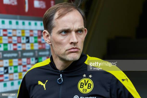 Head coach Thomas Tuchel of Dortmund looks on during the Bundesliga match between FC Augsburg and Borussia Dortmund at the WWKArena on May 13 2017 in...