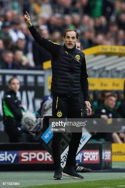 Head coach Thomas Tuchel of Dortmund reacts during the Bundesliga match between Borussia Moenchengladbach and Borussia Dortmund at BorussiaPark on...
