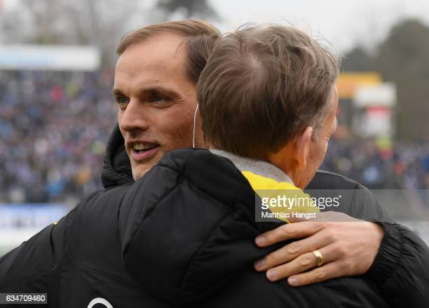 Head coach Thomas Tuchel of Dortmund shakes hands with Hans Joachim Watzke CEO of Borussia Dortmund prior to the Bundesliga match between SV...